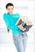 Student woman holding heavy books — Stock Photo