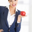 Attractive businesswoman holding red apple — Stock Photo #42731521