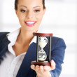 Business woman with hourglass — Stock Photo