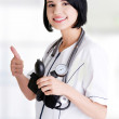 Woman doctor with blood pressure gauge — Stock Photo