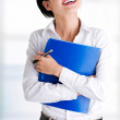 Businesswoman with notepad — Stock Photo