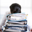 To much work to do. Sad woman with ringbinders — Stock Photo #42733635