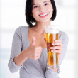 Beautiful and sexy young woman with beer — Stock Photo #42733987