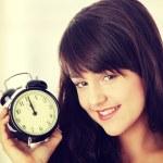 Girl with alarm clock — Stock Photo #42738841