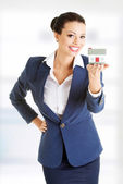 Beautiful businesswoman holding house model — Stock Photo