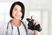 Woman doctor with pressure gauge — Stock Photo