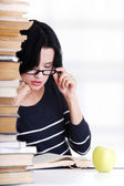 Young student woman studying at the desk — Stockfoto