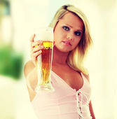 Young atractive blonde and beer — Stock Photo