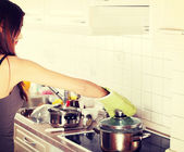 Young woman boiling in pot — Stock Photo