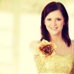Beautiful woman holding gold rose — Stock Photo #42741169