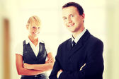 Young attractive business people — Stock Photo
