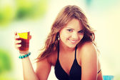 Young woman drinking ice tea — Stock Photo