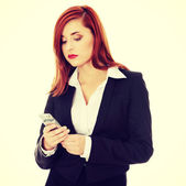 Businesswoman with cellular phone — Stock Photo