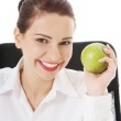 Woman holding an apple — Stock Photo