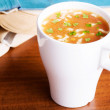 Hot vegetable soup in a cup. — Stock Photo #43578399