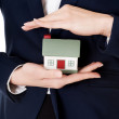 House model in woman's business hands. — Stock Photo