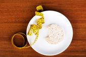 One waffle rice on a plate and measuring tape. — Stock Photo