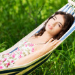 Woman lying and relaxing in a hammock — Stock Photo