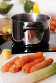 Kitchen pot on an gas plate — Stock Photo