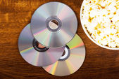 Picture of popcorn in a bowl and CDs. — Stock fotografie