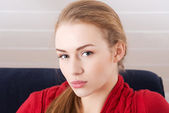 Woman sitting ona couch — Foto Stock