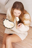 Woman is eating big bowl of ice creams — Stock Photo
