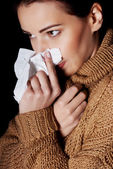 Young woman having depression with tissue. — Stock Photo