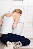 Woman is vomiting — Stock Photo