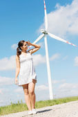 Happy teen girl next to wind turbine. — Stock Photo