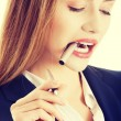 Business woman with pen — Stock Photo #45276497