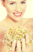 Woman with green cress. — Stock Photo