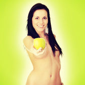 Girl with a green juicy apple — Stock Photo