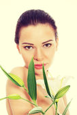 Beautiful woman with white lily. — Stock Photo