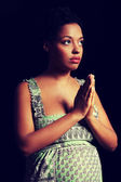 Young afro american pregnant woman praying — Stock Photo
