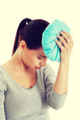 Young beautiful woman is haveng a headache. — Stock Photo