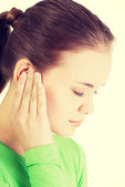 Young woman feeling a pain in ear — Stock Photo