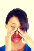 Young woman with sinus pressure pain — Stock Photo