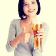 Beautiful and sexy young woman with beer — Stock Photo #47680607