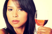 Beautiful woman with glass of rose wine — Stock Photo