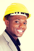 Happy successful businesman in helmet. — Stock Photo