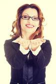 Business woman showing palms — Stock Photo