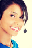 Beautiful young call-center assistant smiling — Stock Photo