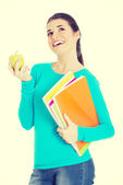 Student with files and apple — Stock Photo