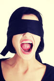 Blindfolded woman screaming — Stock Photo