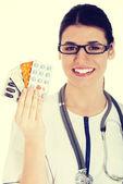 Doctor holding pills — Stock Photo