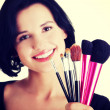 Make-up artist holding brushes — Stock Photo