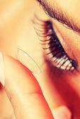 Woman putting contact lens — Stock Photo