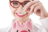 Business woman with piggy-bank — Foto Stock