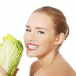 Topless woman with iceberg lettuce — Stock Photo #48786133