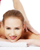 Woman lying and relaxing at spa saloon — Stock Photo